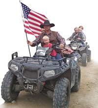 Ryan Bundy, son of Nevada rancher Cliven Bundy, rides his ATV through Recapture Canyon - ERIC TRENBEATH