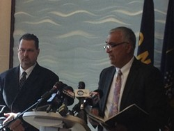 Salt Lake District Attorney Sim Gill (right) addresses a press conference about the arrest of former Attorney General Mark Shurtleff and John Swallow, alongside Davis County Attorney Troy Rawlings (left)