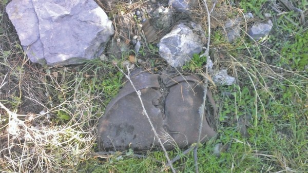 The partially buried oil drum that Russell Ridge found in North Salt Lake in 2013.