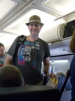rich_piatt_boards_the_flight_with_his_cool_hat.jpg
