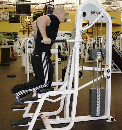 THE WEIGHT-ASSISTED DIP MACHINE BUILDS THE UPPER ARMS (FOCUSING ON THE TRICEPS), PLUS THE CHEST AND SHOULDERS. ADJUST THE RESISTANCE UPWARD EVERY WEEK TO A WEIGHT YOU CAN HANDLE WITH GOOD FORM FOR AT LEAST 12 REPS. REGULAR USE OF THE MACHINE BUILDS THE ENTIRE UPPER BODY. - BY WINA STURGEON