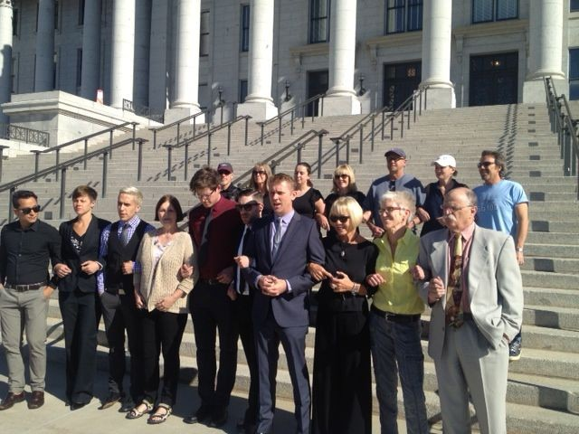"""Troy Williams and the other """"Capitol 13"""" protesters and their lawyers at a press conference challenging their arrest and being charged with """"disrupting the legislative process."""""""