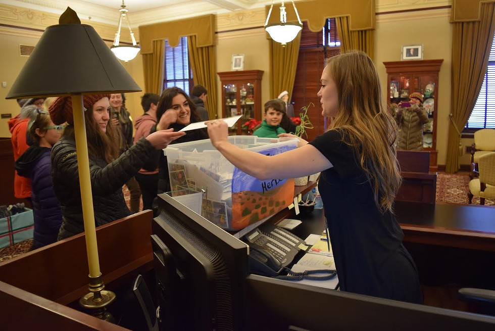 Students drop off the letter bounty in support of public lands to Gov. Gary Herbert's office. - RAY HOWZE