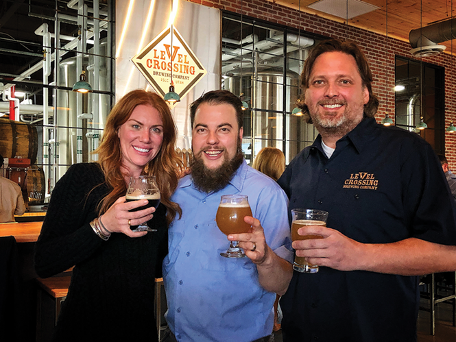 The Level Crossing Brewing Co. braintrust: Business development manager Katie Flanagan, left, head brewer Chris Detrick, middle, and owner Mark Medura - MIKE RIEDEL