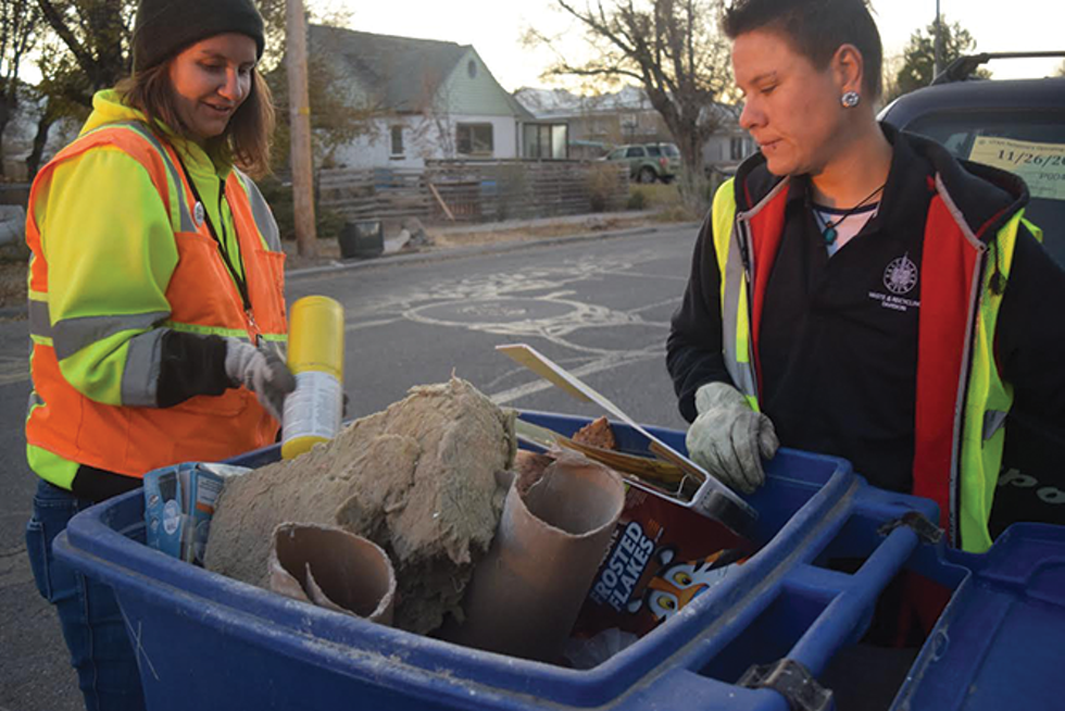 Ashley Bailey, left, and Kellie Ulrich inspect recycling bins in the Glendale neighborhood for misplaced items. - RAY HOWZE