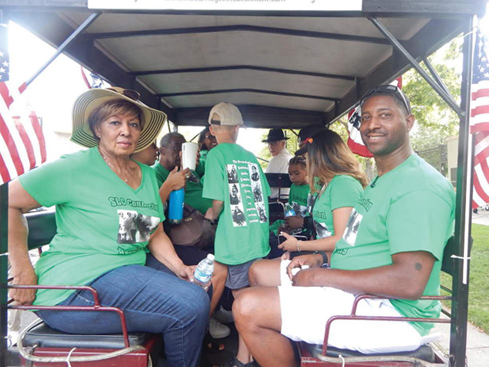 Descendants of slave pioneer Green Flake take part in the Days of '47 Parade. - PETER HOLSLIN