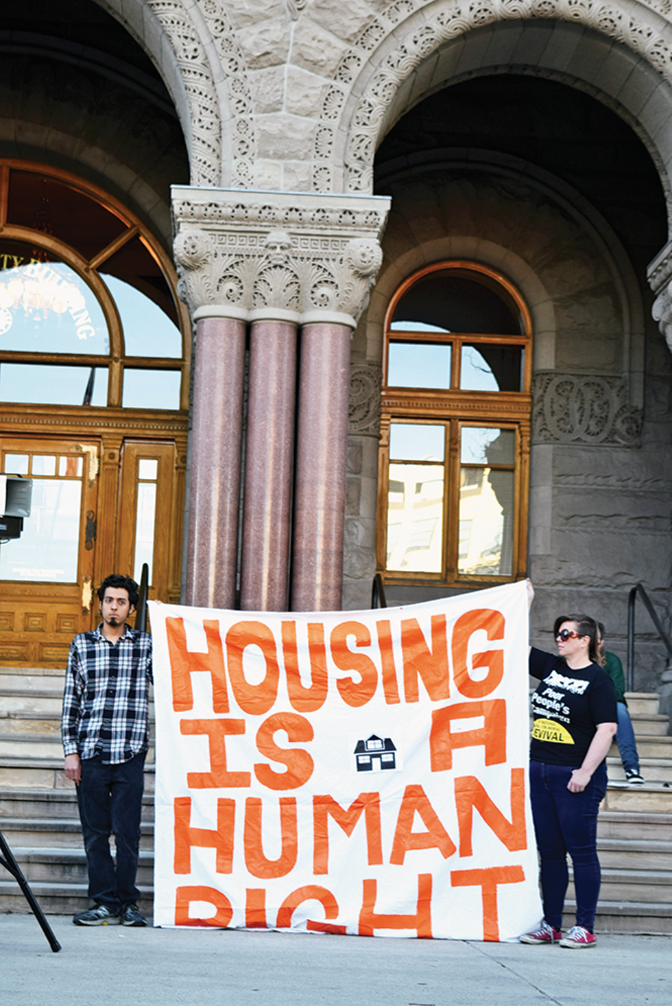 """Aiming for more equitable and affordable housing, activists gathered before a city council meeting in April asking for more to be done for """"housing justice."""" - RAY HOWZE"""