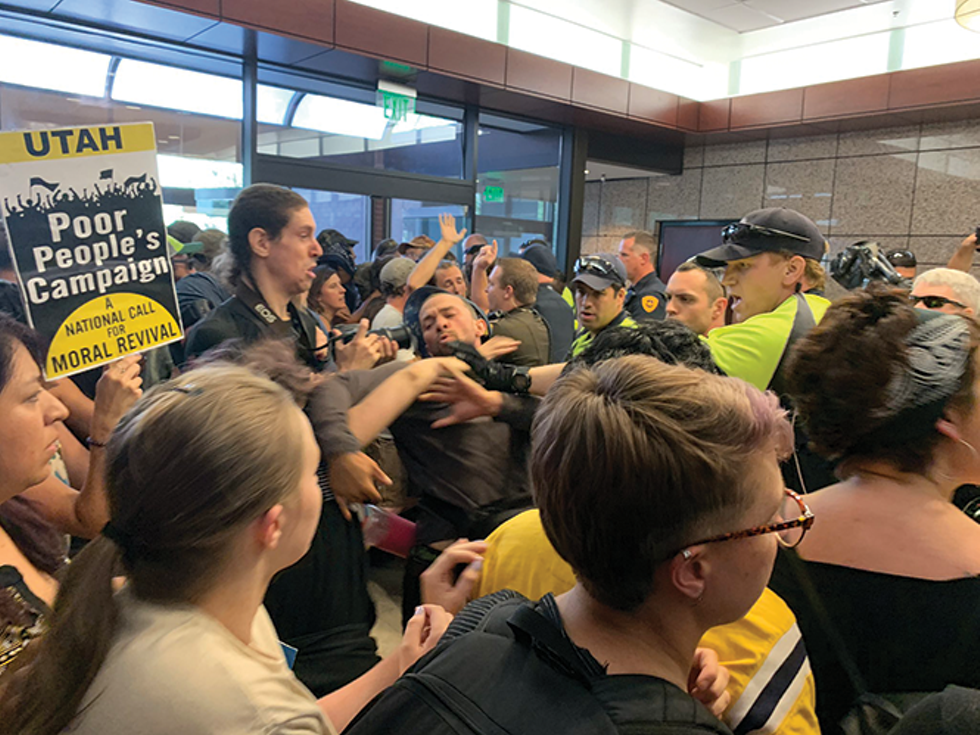 Tensions over the inland port turned confrontational when police and activists lost their cool during a demonstration at the Chamber of Commerce building. - ISAIAH PORITZ
