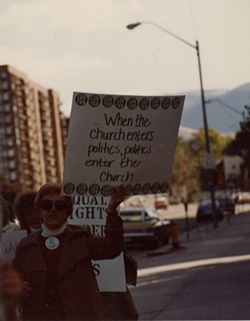 Demonstrators carrying pro-ERA signs march down SLC streets on Oct. 2 1982, during The Church of Jesus Christ of Latter-day Saints' General Conference. - NATIONAL ORGANIZATION FOR WOMEN PHOTOGRAPHY COLLECTION