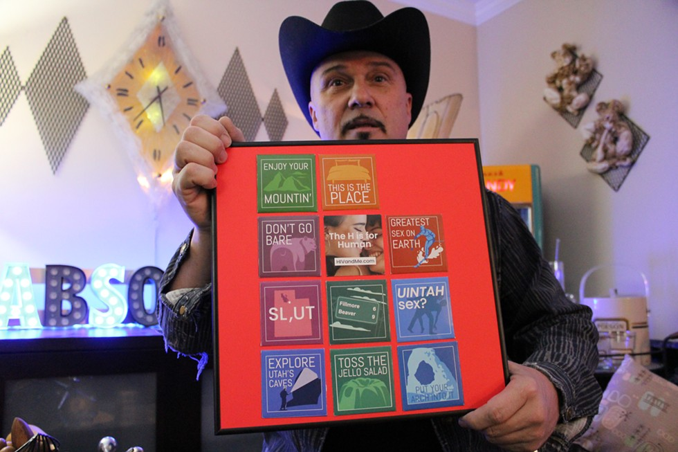 """Michael Sanders shows off a display that's now part of his personal collection on Friday, Jan. 17. Following the headline-making frenzy he dubbed """"condomgate,"""" the HIV advocate and educator's line has been clogged with requests for the coveted condoms. - ENRIQUE LIMÓN"""