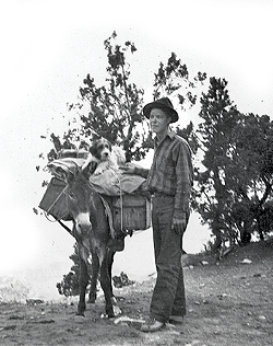 everett_ruess_on_the_trail_with_his_dog.png