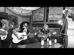 pick_ee_out_the_singers_-_screenshot_of_their_long_black_veil_video.jpg