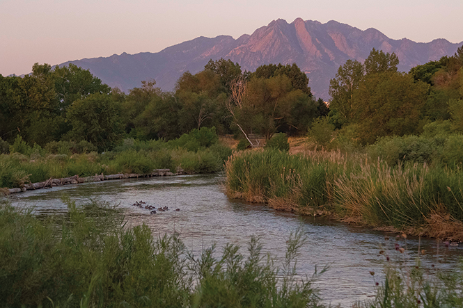 Years of work on the Jordan River, shown here between Murray and Taylorsville near Germania Park, have boosted the river's appeal to recreationalists and developers. - JORDAN ALLRED
