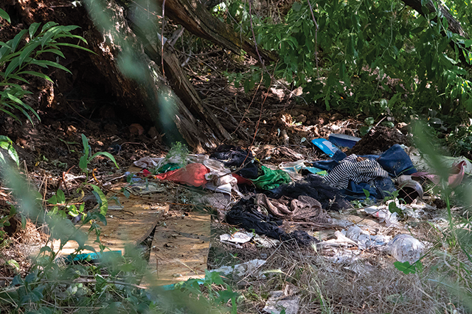 Human impacts:  Garbage and litter next to  an illegal camp on the Jordan River - JORDAN ALLRED