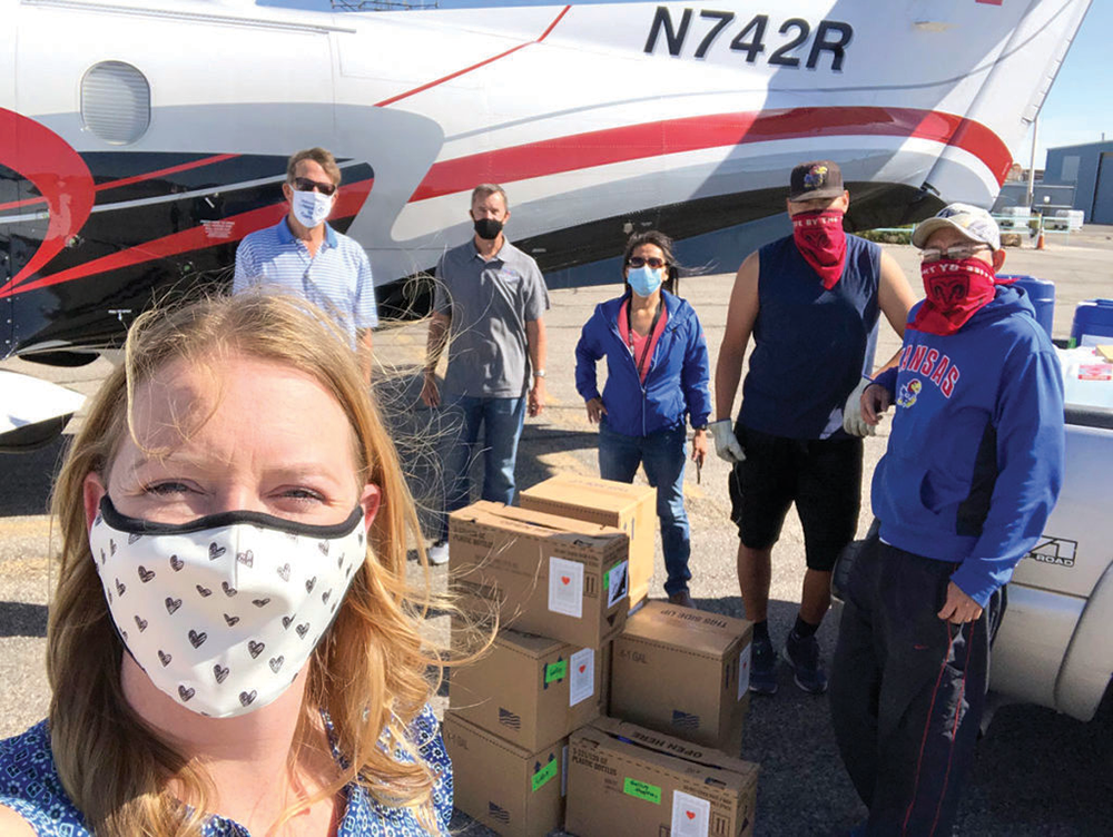 Dr. Thuet, front left, founder of With Love, From Strangers, and her crew load PPE headed to Southwest tribal communities.