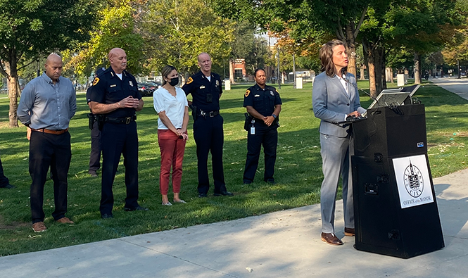 Salt Lake City Mayor Mendenhall, joined by SLCPD Chief Mike Brown and members of the City Council, speaks to the media at Pioneer Park. - BENJAMIN WOOD