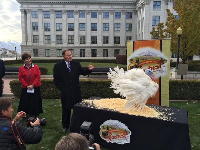 Utah commissioner of agriculture LuAnn Adams looks on as Gov. Gary Herbert pardons Norbert the turkey. - COLBY FRAZIER