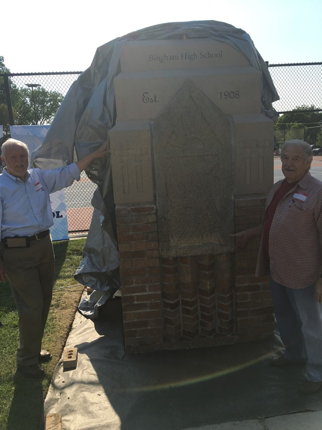 Maynard John Berg and Bill Nicholls unveil the memorial to their beloved Bingham High.