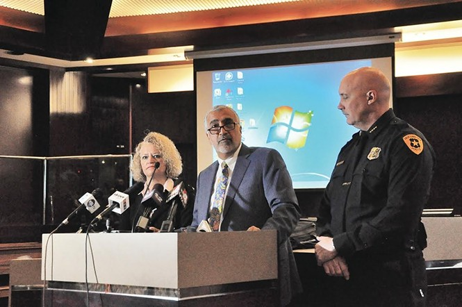 Biskupski and Brown flanking District Attorney Sim Gill at a January 2016 press conference. - COLBY FRAZIER
