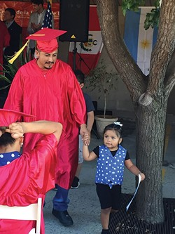For Lázaro Villán and 24 others, Saturday's ceremony was a family affair. - CONNOR RICHARDS