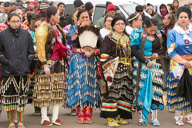 A group of women align to do a traditional dance the day after authorities cleared the front line camp. - WESTON BURY