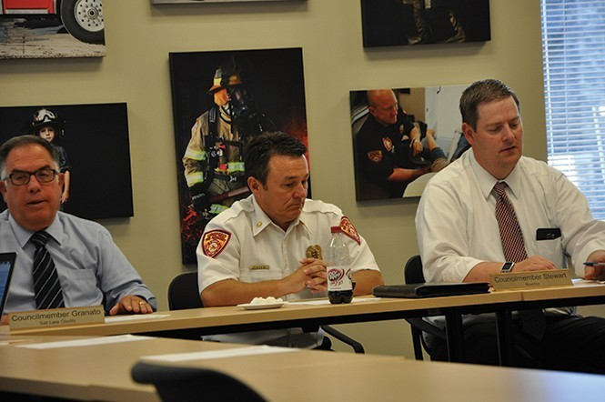 Former UFA Fire Chief Michael Jensen (center) at a July 19, 2016, closed-session meeting during which the board accepted Deputy Chief Gaylord Scott's resignation. - COLBY FRAZIER