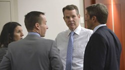 Cara Tangaro (left), Brad Anderson (center) and Scott Williams (right) surround their client, John Swallow. - AL HARTMANN