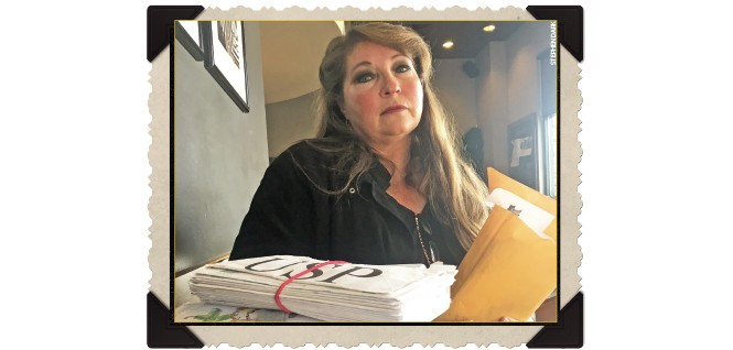 Alison Payne with some of the several hundreds of letters her son sent her from prison.