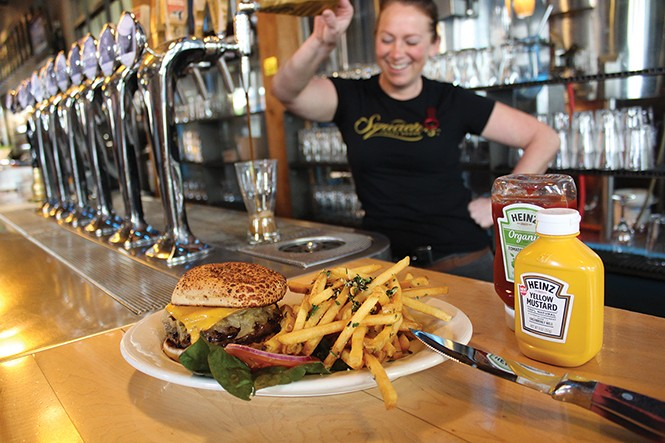 The classic burger, topped with cheddar cheese and bourbon-garlic caramelized onions, is among the many menu items at Squatters. - ENRIQUE LIMON