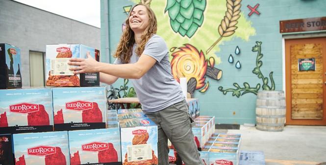 17. Brewer Lauren Lerch stacks boxes awaiting transport to fridge storage.