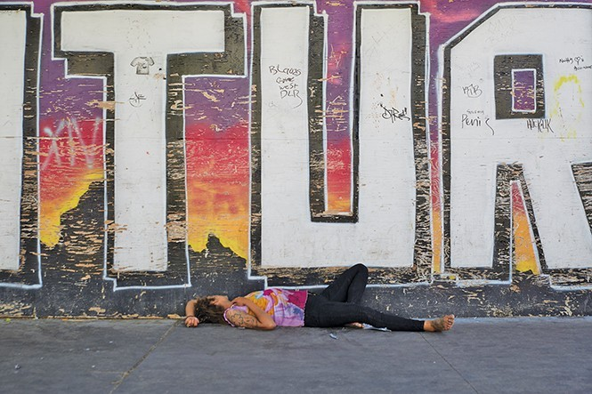 Scenes like the above are commonplace around the downtown shelter's perimeter. - STEVEN VARGO/FILE