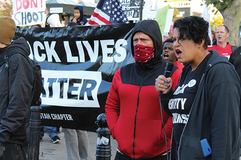 Black Lives Matter organizer Lex Scott leads supporters on a march to the City and County Building following Sunday's protest. - ENRIQUE LIMON
