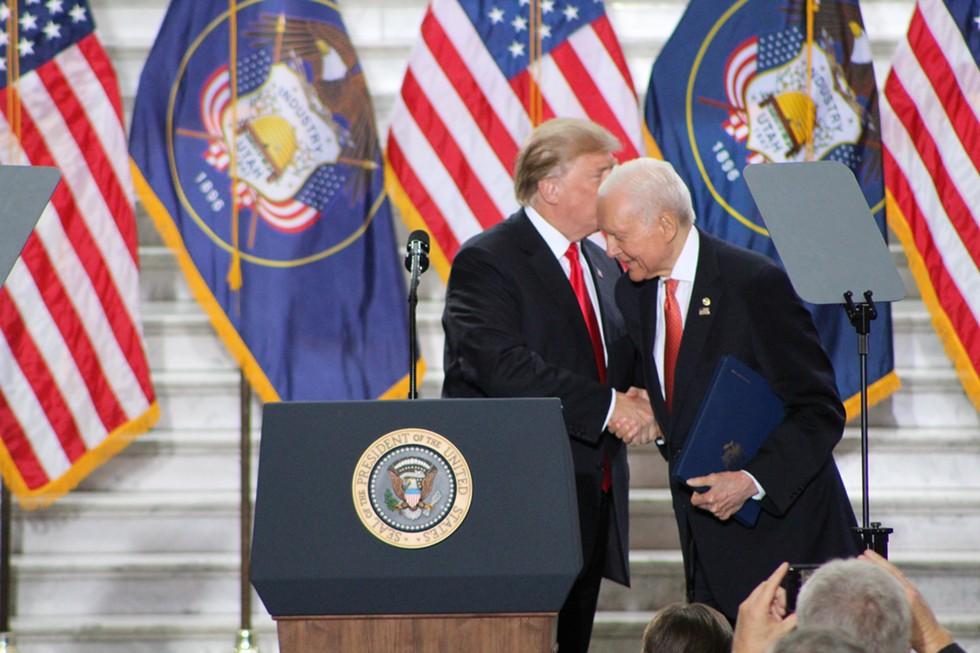President Donald Trump greets the long-serving senator inside the Utah State Capitol on Dec. 4, 2017. - ENRIQUE LIMÓN
