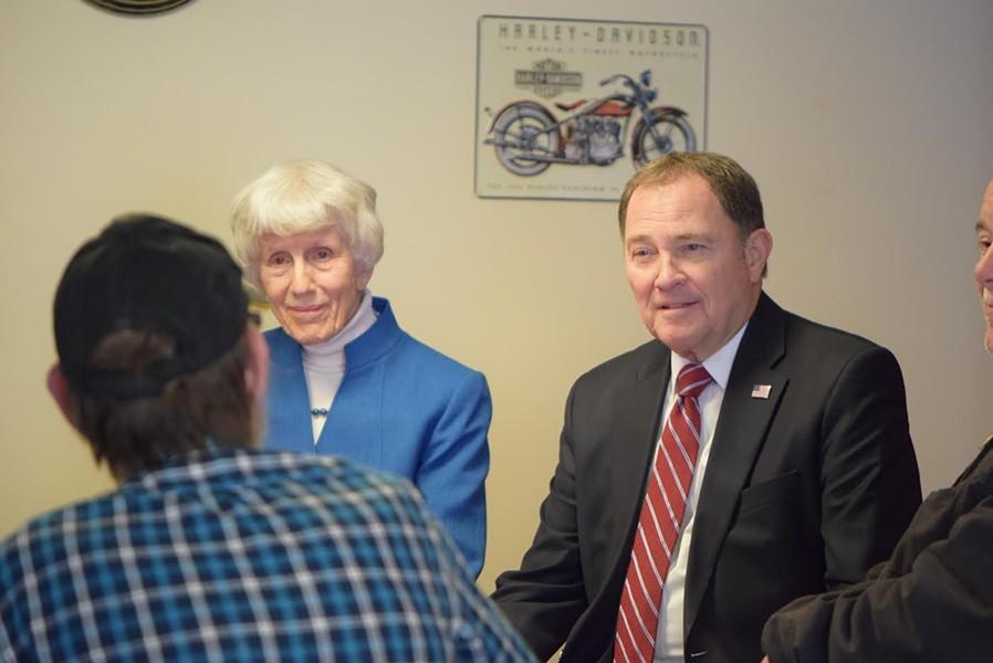 Pamela Atkinson, left, and Gov. Gary Herbert talk to veterans at Freedom Landing. - RAY HOWZE