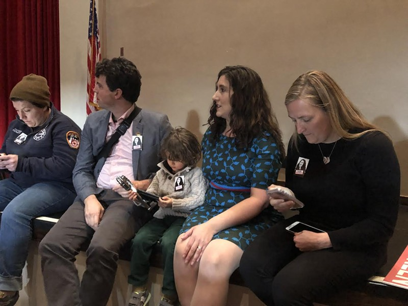 Accompanied by her husband Nicholas Steffens and son Desmond, Ghorbani awaits her fate during a recent meeting of the Salt Lake County Democratic Central Committee. - KELAN LYONS