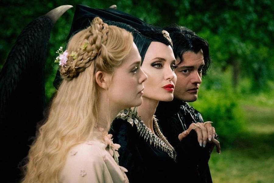 Elle Fanning, Angelina Jolie and Sam Riley in Maleficent: Mistress of Evil - WALT DISNEY PICTURES