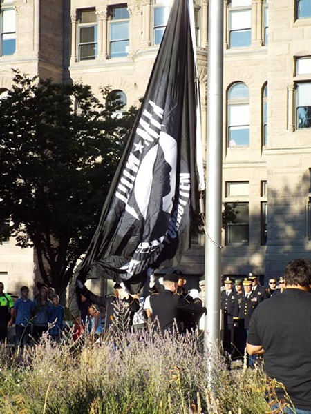 Army officials raise the MIA/POW flag at the Salt Lake City and County building. - BEN MARTINEZ