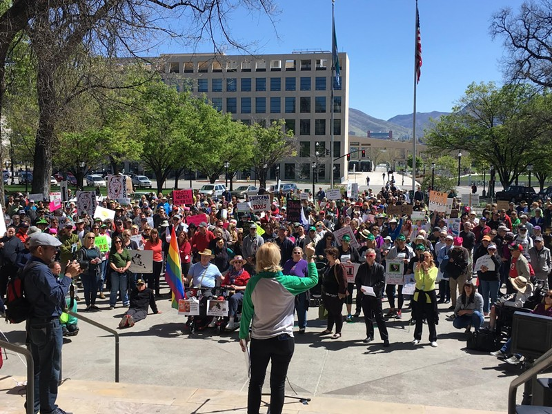 Stacy Hughes, coordinator for the Utah Trump Tax March, addresses the crowd. - DW HARRIS
