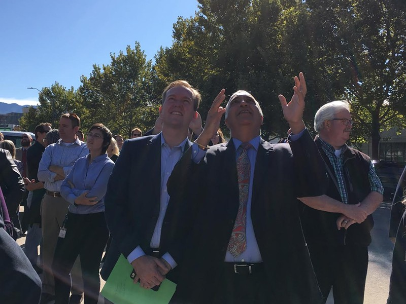 Salt Lake County Mayor Ben McAdams (L) and SL County DA Sim Gill (R) marvel at the art on the side of the new DA building on Wednesday. - DW HARRIS