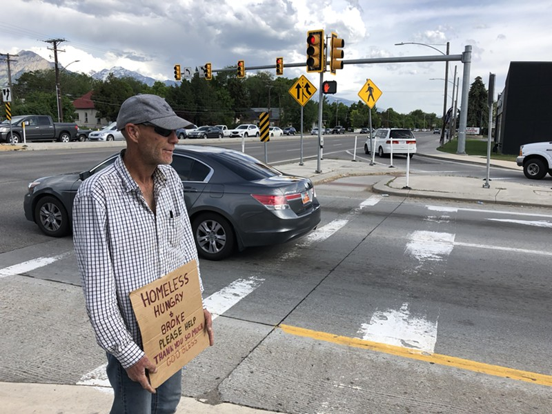 As he stands with his sign on 700 East, Martin says he understands the new laws regarding roadside panhandling and tries to stay out of trouble. - KELAN LYONS