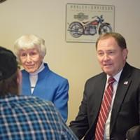 Pamela Atkinson, left, and Gov. Gary Herbert talk to veterans at Freedom Landing.