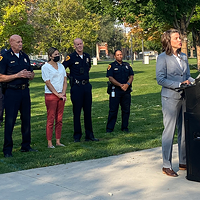 Salt Lake City Mayor Mendenhall, joined by SLCPD Chief Mike Brown and members of the City Council, speaks to the media at Pioneer Park.
