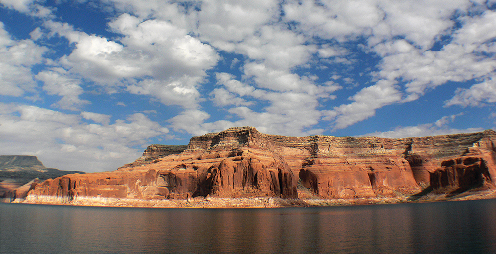 The state is seeking $1.9 billion in damages—the amount the Utah attorney general believes it would cost to locate and remove the metals, thought to be buried in the sediment beneath Lake Powell. - BERNARD SPRAGG VIA WIKIMEDIA COMMONS
