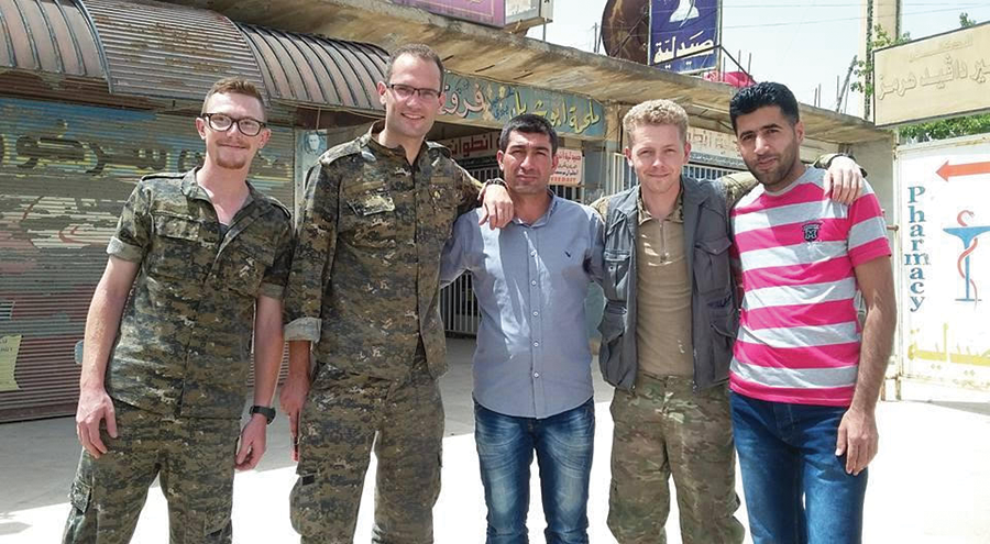 """Porter Goodman, second from right, believes the new form of democracy being implemented by the Kurds is the """"democratic confederalist revolution."""" - COURTESY PHOTO"""