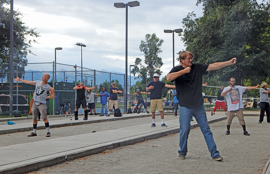 Tai Chi with the homeless at Pioneer Park. - PETER HOLSLIN