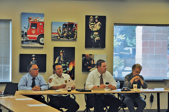 Former UFA Fire Chief Michael Jensen (center) at a July 19, 2016, closed-session meeting, during which the board accepted Deputy Chief Gaylord Scott's resignation. - COLBY FRAZIER