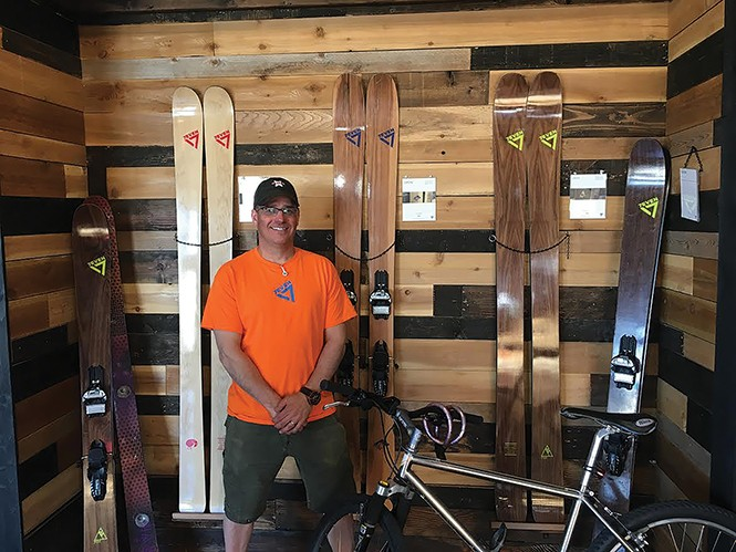 Todd Herilla with some of his custom ski models. - STEPHEN DARK