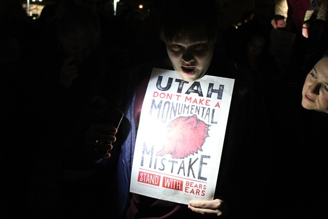 A protester outside Jason Chaffetz' Feb. 9 town hall. - ENRIQUE LIMÓON