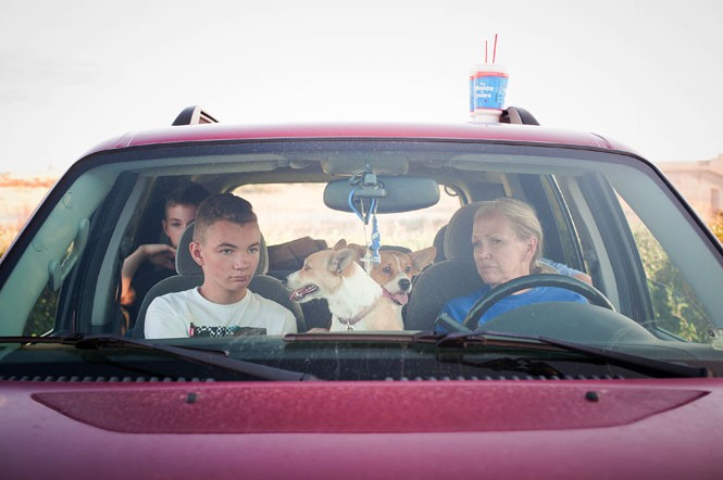 Victoria Cordero, right, with her sons Kacey (front seat) and Austin, plus their two dogs. The family has been unable to make ends meet since being evicted in 2013 and choose to live in their car rather than go to a homeless shelter - NIKI CHAN