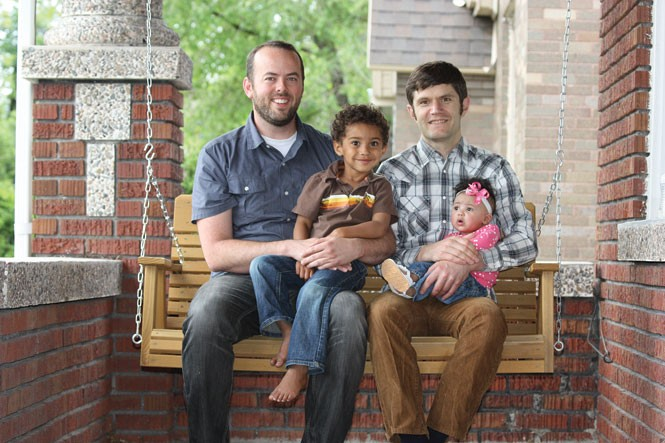 Weston Clark (left) with his partner and their two children.